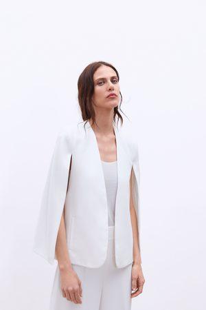 Zara Kappe med åpninger