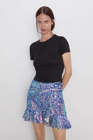Zara Miniskjørt med paljetter og volang