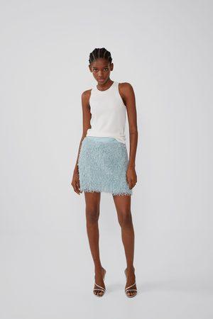Zara Miniskjørt med fjæreffekt