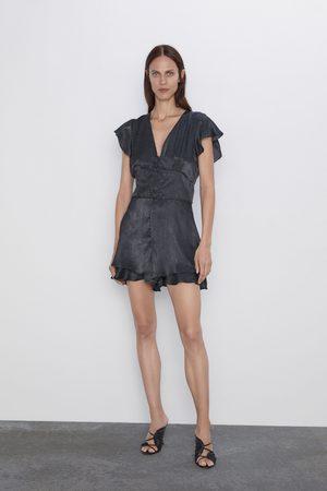 Zara Jumpsuit med volanger og prikker