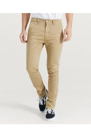 Nudie Chinos Slim Adam Natur