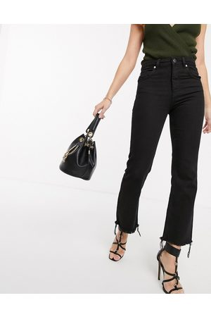 ASOS Egerton rigid cropped flare jeans in washed black with raw hem