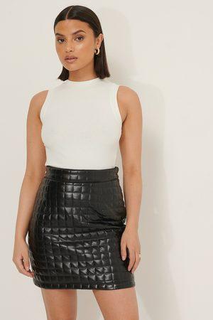 Selma Omari x NA-KD Quilted Mini Skirt