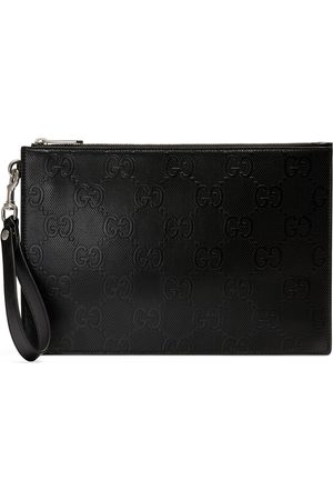 Gucci Herre Clutches - GG embossed pouch