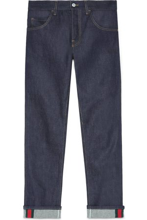 Gucci Tapered denim trousers with Web
