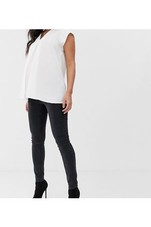 ASOS ASOS DESIGN Maternity high rise ridley 'skinny' jeans in washed black with under the bump waistband
