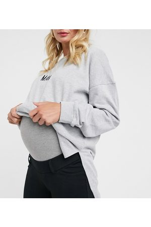 Mama Licious Mamalicious Maternity over the bump jersey trousers in black