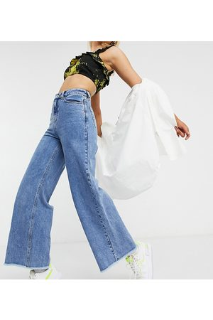 COLLUSION X008 wide leg jeans in stonewash blue