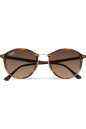Ray-Ban 0RB4242 Round Sunglasses Light Havana/Brown