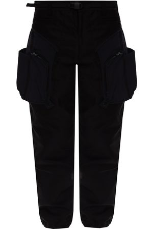 WHITE MOUNTAINEERING Trousers with several pockets