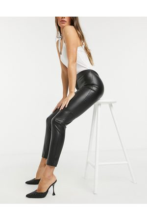 MANGO Dame Leggings - Faux leather skinny trousers in black