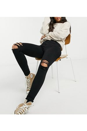 Dr Denim Lexy mid rise super skinny jeans with ripped knees in black