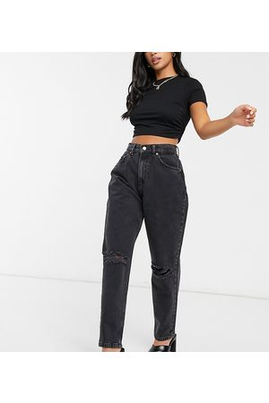 ASOS ASOS DESIGN Petite high rise 'slouchy' mom jeans in washed black with rips