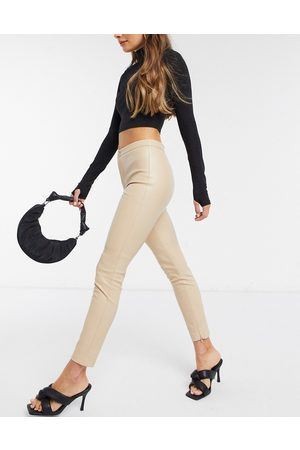 MANGO Faux leather skinny trousers in