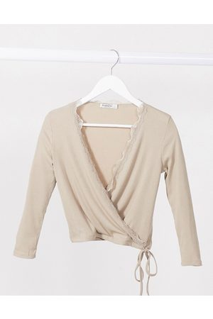Stradivarius Wrap long sleeve top with lace detail in