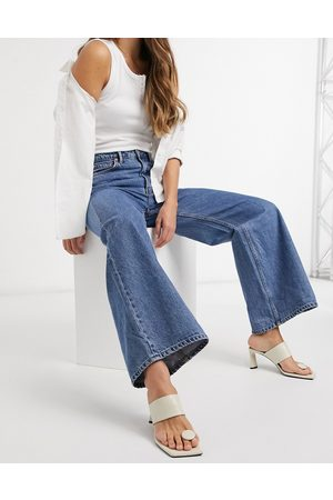 Weekday Ace organic cotton high waist wide leg jeans in mid blue