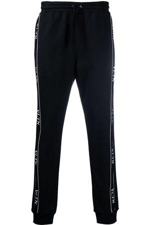 VALENTINO Logo tape track trousers