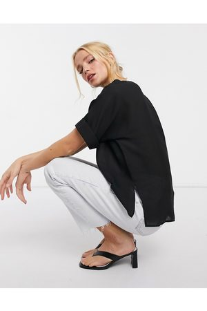 ASOS Oversized woven tee with roll sleeve in black-White