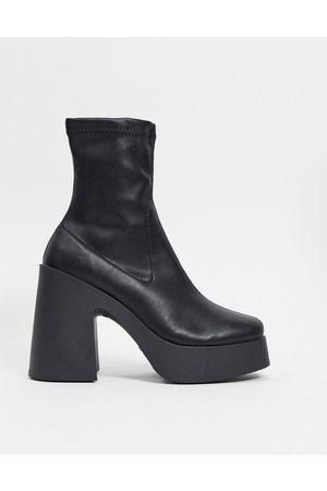 ASOS Elsie high heeled sock boot in black pu