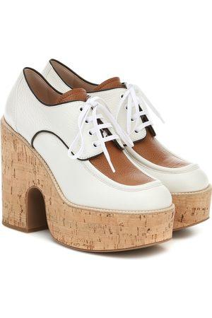 Miu Miu Leather and cork platforms