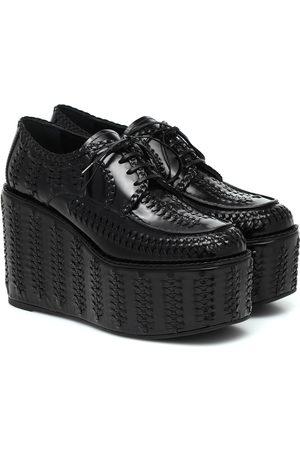 Prada Woven leather platform brogues