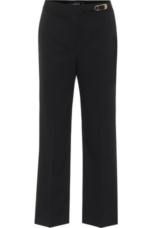 VERSACE Embellished stretch-wool pants