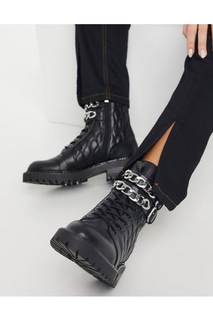 Stradivarius Quilted chain detail boots in black