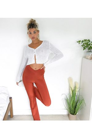COLLUSION Dame Leggings - Dipped waist disco flares in rust-Brown