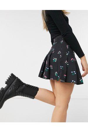 Skinnydip Pleated tennis skirt in floral print-Black