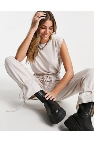 ASOS Shoulder pad tie ankle jogger jumpsuit in stone-Cream