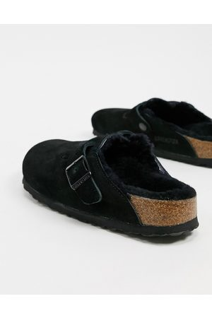 Birkenstock Boston clogs in black with fur lining