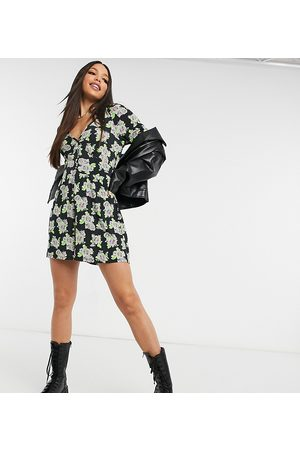 ASOS ASOS DESIGN tall button front playsuit in spaced floral print-Multi