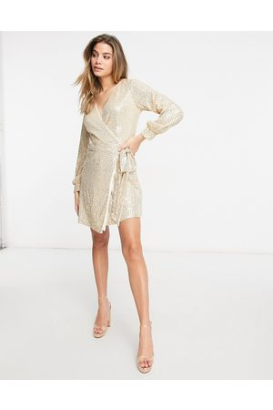 Chi Chi London Sequin wrap tie mini dress in light gold