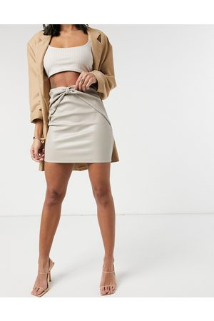 ASOS Leather look mini skirt with knot front waist detail in stone