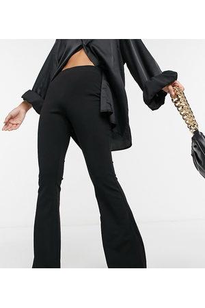 ASOS ASOS DESIGN Petite jersey slim kick flare suit trouser-Black