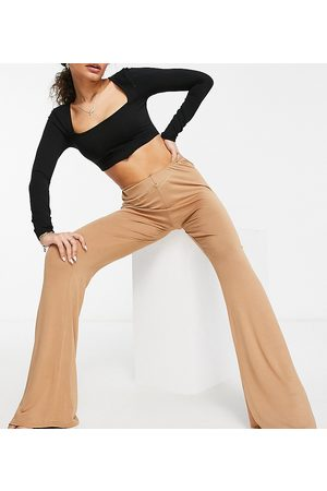 Fashionkilla Kick flare trousers with hip strap in camel-Tan