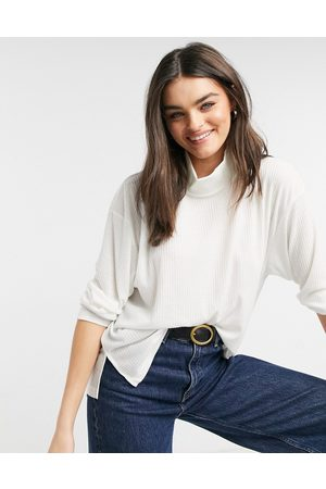 ASOS Oversized top in drapey rib with structured high neck in cream-White