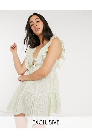 Fashion Union Exclusive mini swing beach dress in ditsy floral print-White