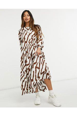 Glamorous Maxi smock dress with tiered skirt and bib collar in tonal tiger print-Cream