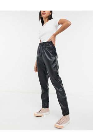 Pieces Leather look trousers with elasticated waist in black