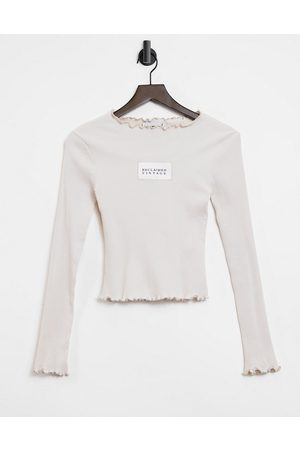 Reclaimed Vintage Inspired rib top in ecru with lettuce hem and logo-White