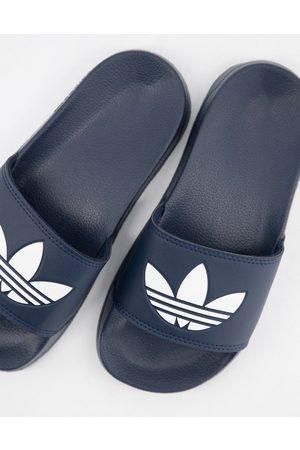 adidas Dame Flip flops - Adilette Lite sliders in navy