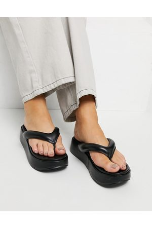 ASOS Ferris chunky flip flop sandals in black