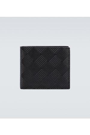Bottega Veneta Debossed leather bifold wallet