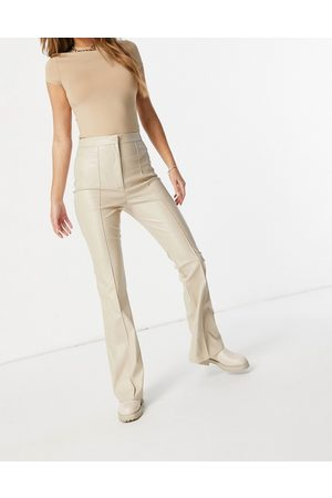 ASOS Jersey leather look kickflare in cream-Stone