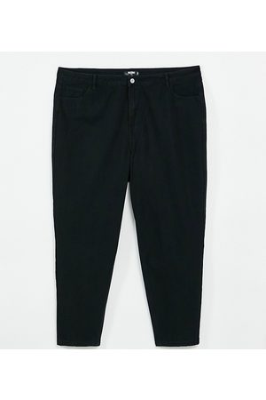 Missguided Riot high rise mom jeans in black