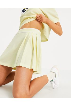 adidas Tennis Luxe' logo pleated skirt in hazy yellow