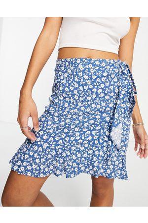 New Look Ruffle wrap mini skirt in blue ditsy