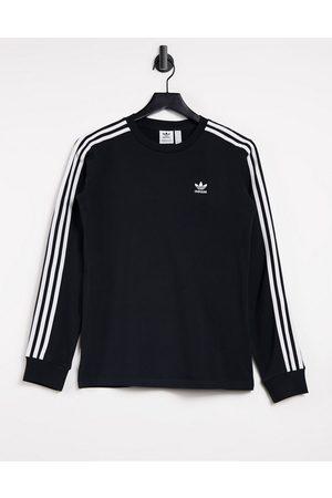adidas Adicolor three stripe long sleeve t-shirt in black