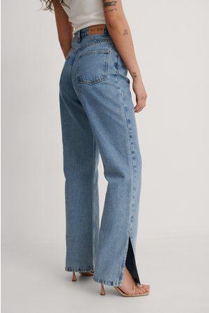 NA-KD Trend Dame Jeans - Resirkulerte Denim Med Sidesplitt Og Høyt Liv